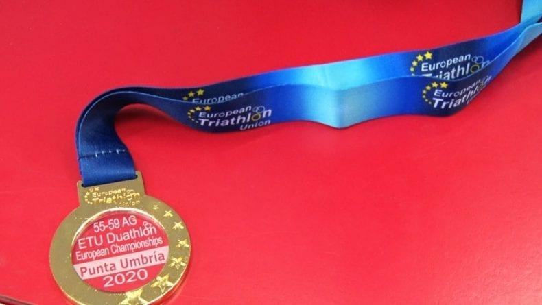 Medalla de oro en el grupo de edad de 55 a 59 años